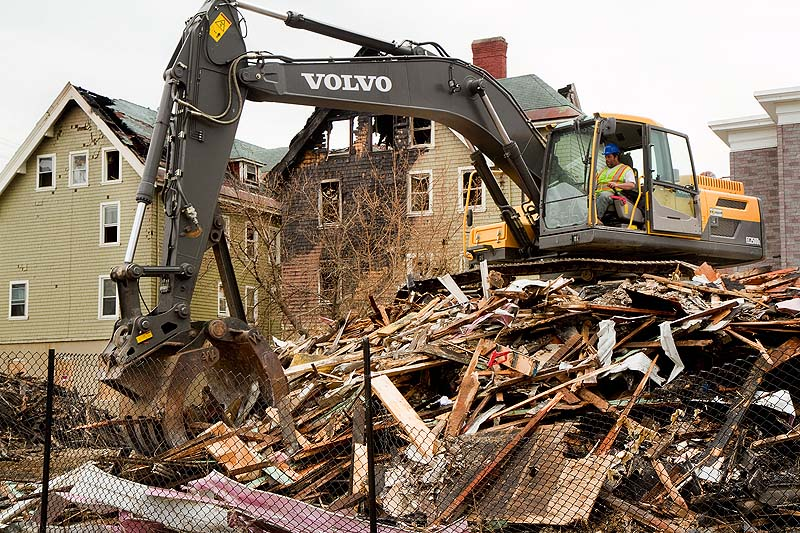 A demolition crew cleans up the rubble from a Blake Street fire in Lewiston on Thursday. Lewiston police charged a 12-year-old boy with setting the fire, who has since turned 13.