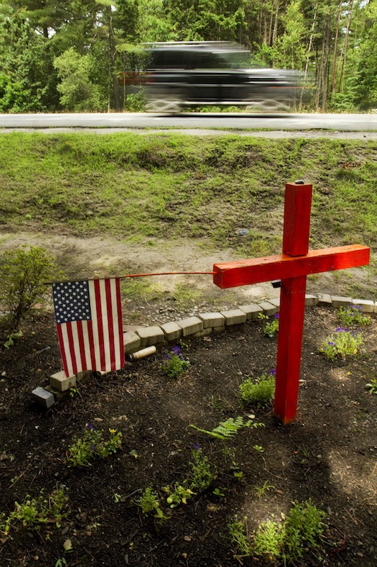 A roadside memorial occupies the location of a fatal accident on Payne Rd., near Holmes Road, in Scarborough on Sunday, June 30, 2013. Roadside memorials have become the centerpiece of a debate as the Scarborough Town Council considers a proposed ordinance that would regulate them. The Town Council will discuss the ordinance at its July 17 meeting.