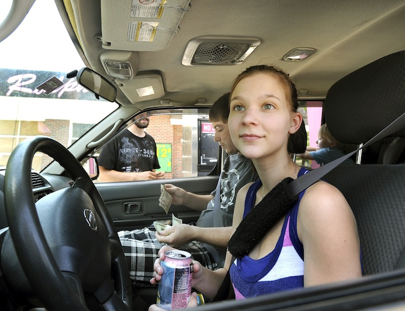 Tanika Newell from Westbrook gets gas at Ralph's/Holly's in Westbrook as she and other motorists react to higher gas prices on Monday, July 15, 2013.