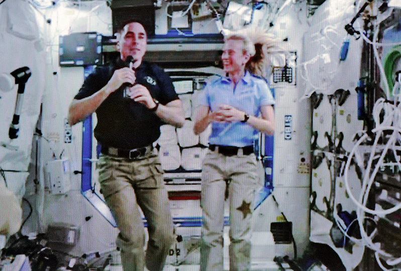 A video of astronauts Chris Cassidy, left, who is from Maine, and Karen Nyberg streams live from the Space Station via the NASA website as they participate in an interview with Press Herald Staff Writer Gillian Graham on Thursday.
