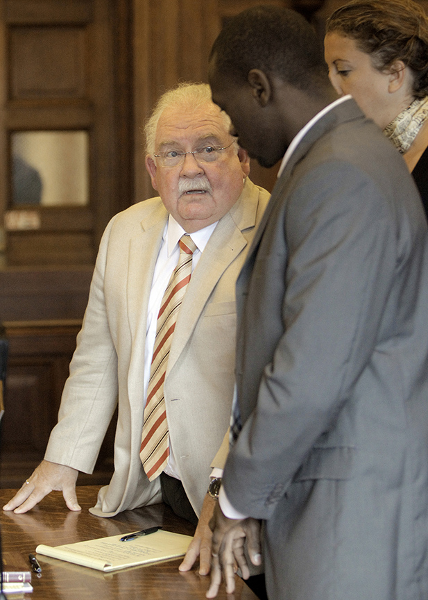 Gabe Souza/Staff Photographer Attorney Daniel Lilley consults with his client Eric Gwaro, Monday, July 29, 2013, after Gwaro was found guilty of aggravated assault, but not guilty of attempted murder.