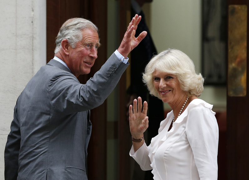 Britain's Prince Charles and his wife Camilla, Duchess of Cornwall, arrive Tuesday at St. Mary's Hospital in London, where Kate, Duchess of Cambridge, gave birth to a baby boy on Monday.