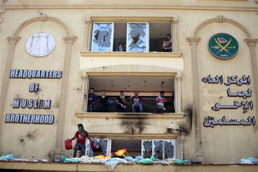 Protesters stormed and ransacked the headquarters of President Mohammed Morsi's Muslim Brotherhood group early Monday, in an attack that could spark more violence as demonstrators gear up for a second day of mass rallies aimed at forcing the Islamist leader from power. AP Photo/Khalil Hamra.