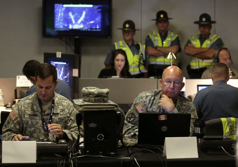 Law enforcement officials monitor surveillance cameras as part of an increased security effort for the Independence Day celebration, the first major public gathering since the Boston Marathon bombings, at the Unified Command Center on Wednesday in Boston.