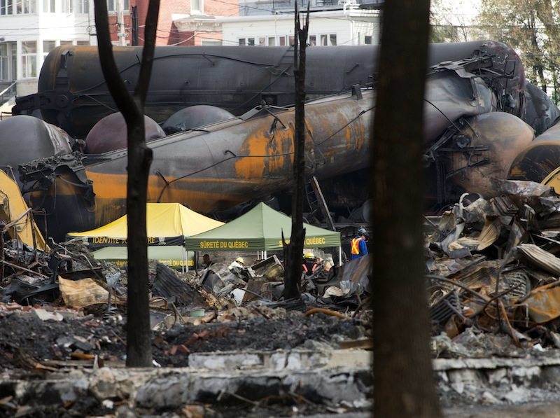 Wrecked tanker cars are pictured during cleanup on Tuesday, July 16, 2013, at the crash site of the train derailment and fire in Lac-Megantic, Quebec. The derailment July 6, 2013, left 37 people confirmed dead and another 13 missing and presumed dead. (AP Photo/The Canadian Press, Ryan Remiorz)