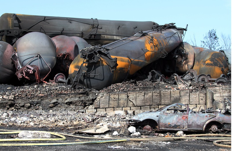 This photo provided by Surete du Quebec, shows wrecked oil tankers and debris from a runaway train on Monday, July 8, 2013 in Lac-Megantic, Quebec, Canada. A runaway train derailed igniting tanker cars carrying crude oil early Saturday, July 6 At least 50 people were confirmed dead in a catastrophe that raised questions about the safety of transporting oil by rail instead of pipeline. (AP Photo/Surete du Quebec, The Canadian Press)