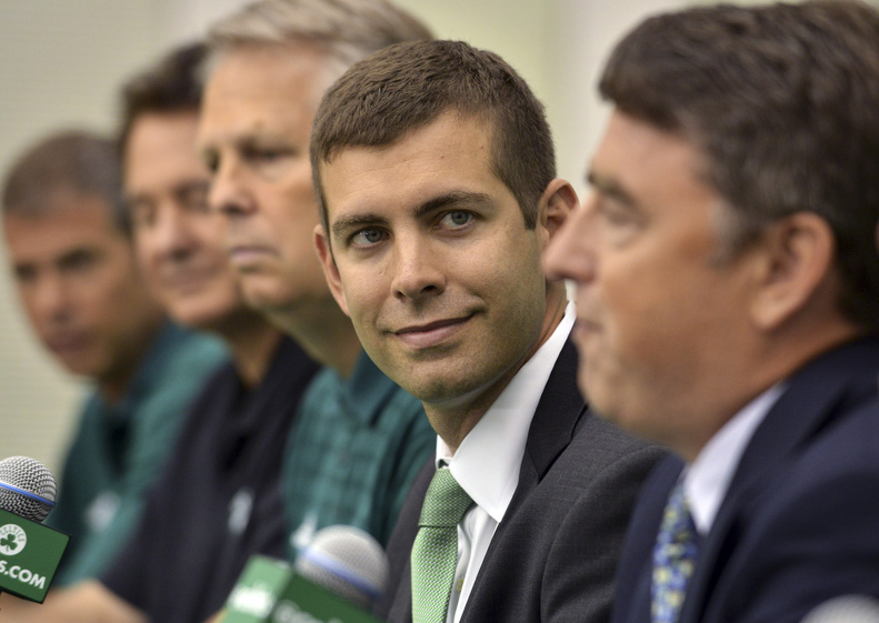 New Boston Celtics head coach Brad Stevens center, sits with, from left, Celtics President Rich Gotham, co-owner Stephen Pagliuca, General Manager Danny Ainge and co-owner and CEO Wyc Grousbeck, right, during a news conference Friday in Waltham, Mass.