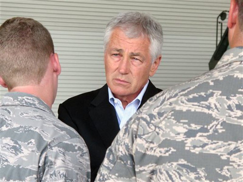 Defense Secretary Chuck Hagel talks with Air Force personnel at Joint Base Charleston near Charleston, S.C., on July 17, the last day