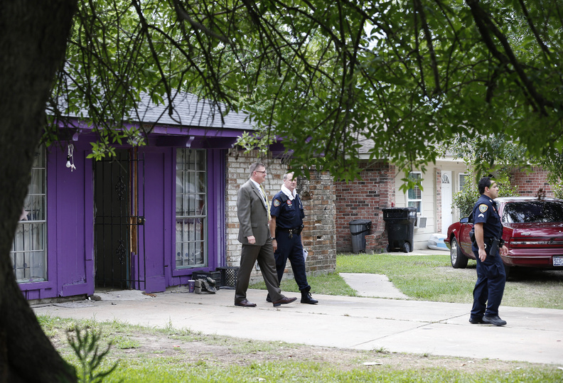 Authorities investigate at a home Friday in Houston where police say four homeless men were found in deplorable conditions.