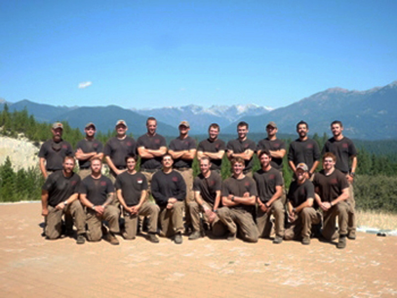 Unidentified members of the Granite Mountain Interagency Hotshot Crew from Prescott, Ariz., pose together in this undated photo provided by the City of Prescott. Some of the men in this photograph were among the 19 firefighters killed while battling an out-of-control wildfire near Yarnell, Ariz., on Sunday, according to Prescott Fire Chief Dan Fraijo.