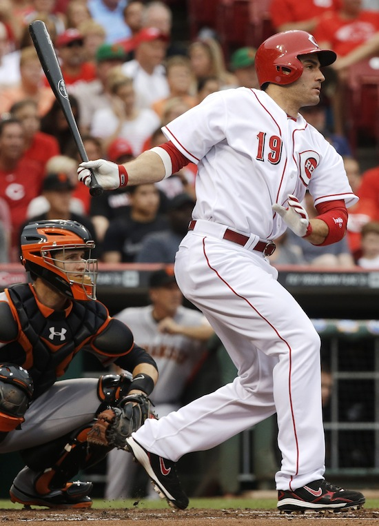 Cincinnati Reds' Joey Votto follows through on a double off San Francisco Giants starting pitcher Barry Zito in the first inning of a baseball game, Wednesday, July 3, 2013, in Cincinnati. (AP Photo/Al Behrman)