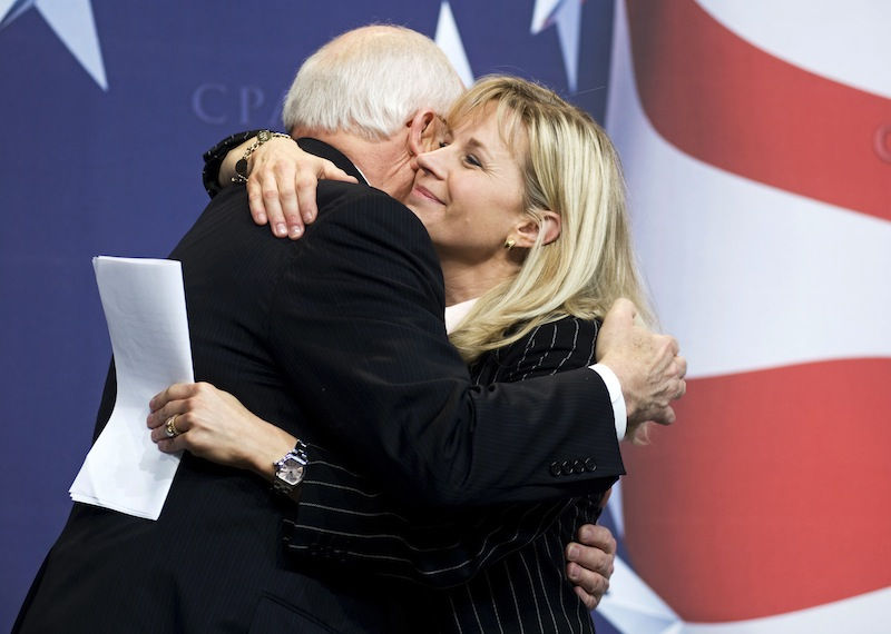 This Feb. 18, 2010 file photo shows Former Vice President Dick Cheney hugs his daughter, Liz Cheney, at the Conservative Political Action Conference (CPAC) in Washington. Liz Cheney says she will run against Wyoming's senior U.S. senator in next year's Republican primary. (AP Photo/Cliff Owen, File)