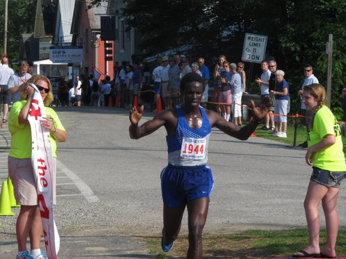 Moninda Marube of Auburn beat the heat and the field of 2,011 finishers to win Thursday's 37th Annual Bridgton 4 on the Fourth Road Race.