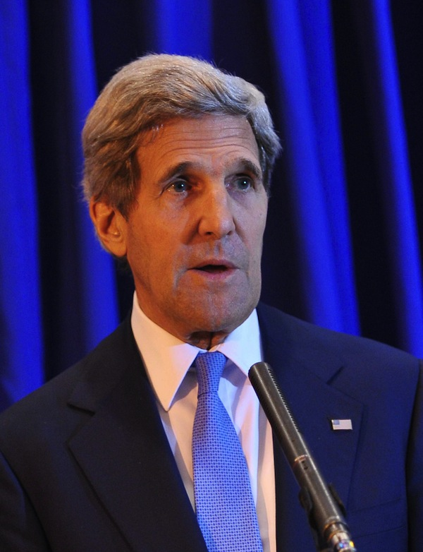 U.S. Secretary of State John Kerry speaks during a press conference at Queen Alia International Airport on Friday, July 19, 2013. Kerry says Israel and the Palestinians will meet soon in Washington to finalize an agreement on relaunching peace negotiations for the first time in five years. Kerry has told reporters that he and the two sides