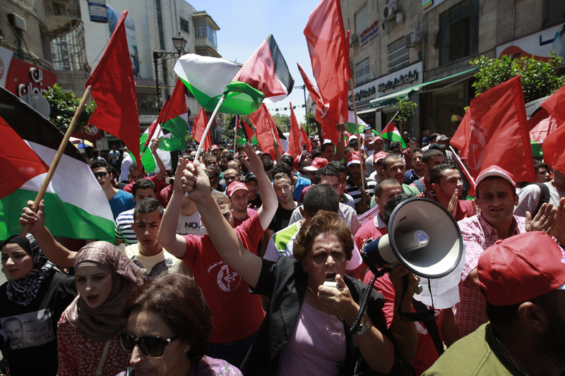 Palestinians protest Sunday in the West Bank city of Ramallah against resuming peace talks with Israel.