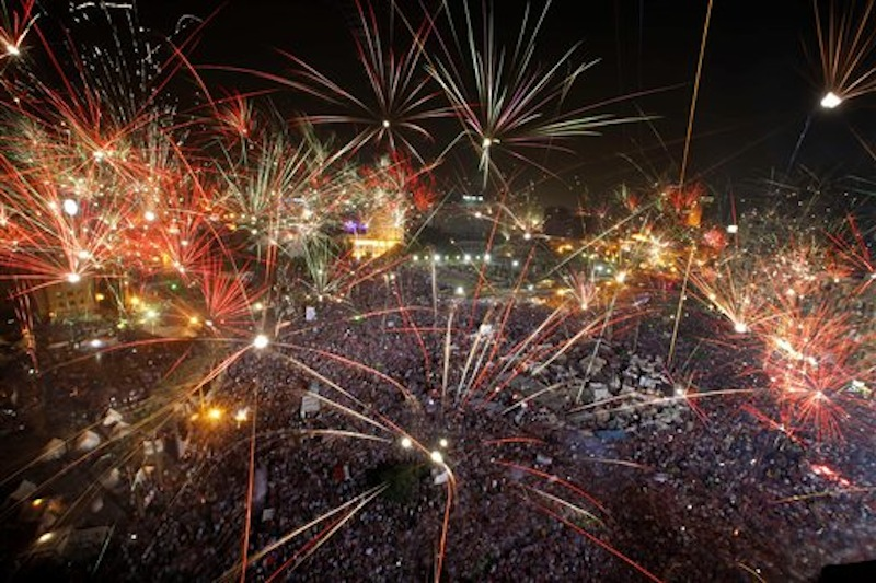 Fireworks light the sky opponents of Egypt's Islamist President Mohammed Morsi celebrate in Tahrir Square in Cairo, Egypt, Wednesday, July 3, 2013. A statement on the Egyptian president's office's Twitter account has quoted Mohammed Morsi as calling military measures