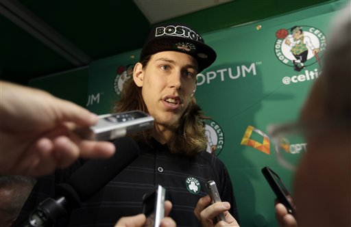 Boston Celtics 2013 NBA basketball draft pick Kelly Olynyk faces reporters following a news conference in Boston on July 1, 2013.