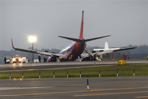 A Southwest Airlines plane rests on the tarmac after a nose gear collapse during a landing at LaGuardia Airport on Monday in New York.