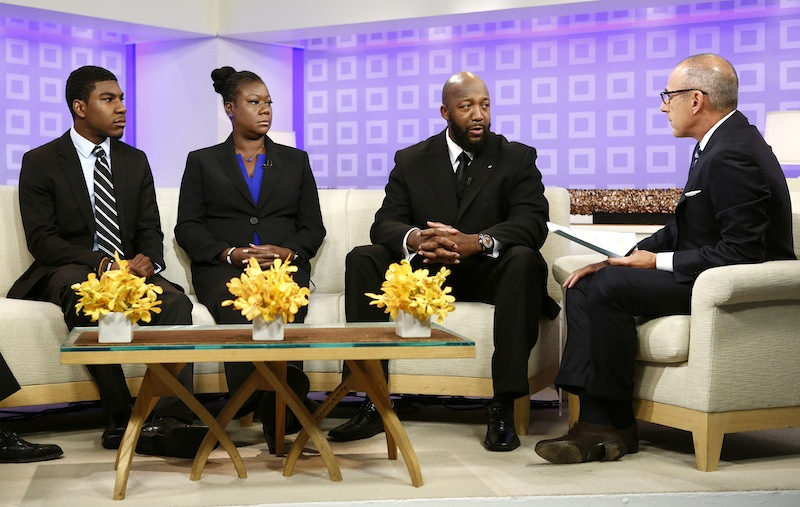In this image released by NBC, parents of Trayvon Martin, Sybrina Fulton, second left, and Tracy Martin, second right, appear on the