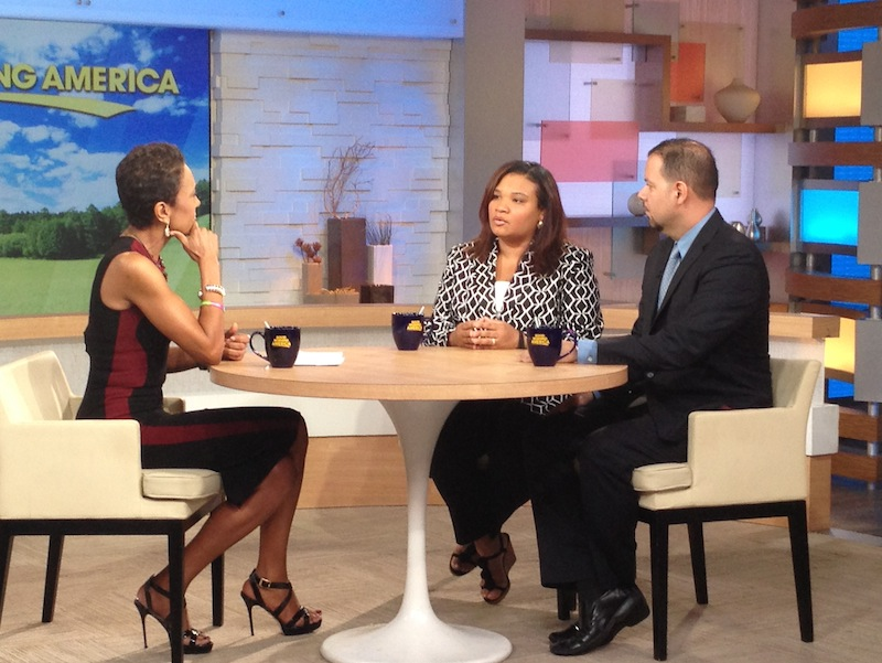 This image released by ABC shows host Robin Roberts, left, with Juror B29 from the George Zimmerman trial, center, and attorney David Chico on