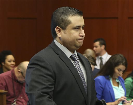 George Zimmerman enters the courtroom for his trial in Seminole circuit court in Sanford, Fla., on Wednesday. Zimmerman has been charged with second-degree murder for the 2012 shooting death of Trayvon Martin.