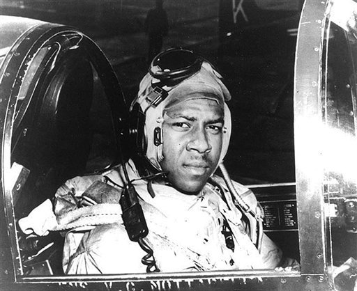 In this undated file photo from around 1950 provided by the U.S. Navy, Ensign Jesse Brown, who died in December 1950 after his plane crashed in North Korea, sits in the cockpit of his plane.