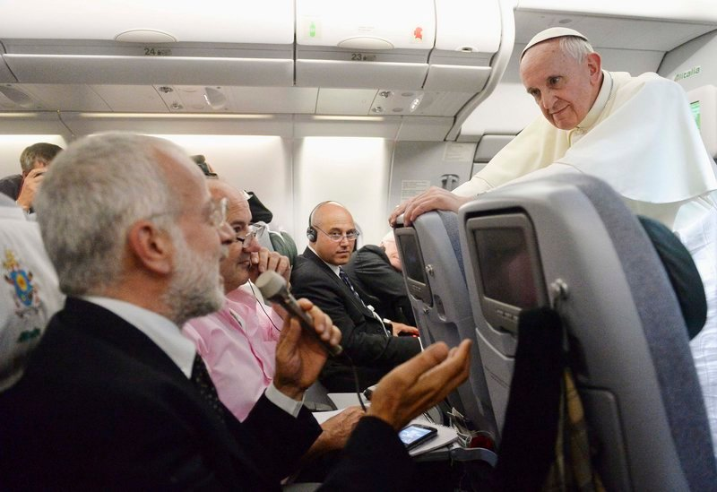 Pope Francis listens to a journalist's question as he flies back to Rome following his visit to Brazil July 29, 2013. Pope Francis, in some of the most conciliatory words from any pontiff on gays, said they should not be judged or marginalised and should be integrated into society, but he reaffirmed Church teaching that homosexual acts are a sin. In a broad-ranging 80-minute conversation with journalists on the plane bringing him back from a week-long visit to Brazil, Francis also said the Roman Catholic Church's ban on women priests was definitive, although he would like them to have more leadership roles in administration and pastoral activities. (REUTERS/Luca Zennaro/Pool) :rel:d:bm:GF2E97T12SD01