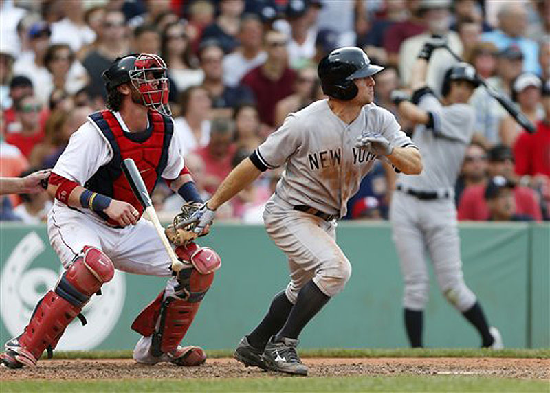 Yankee Brett Gardner watches his single in front of Red Sox catcher Jarrod Saltalamacchia in the seventh inning at Fenwy Park in Boston on Saturday.