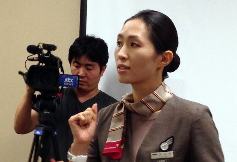 Asiana Airlines Flight 214 flight attendant and cabin manager, lee yoon Hye, speaks to the media during a news conference in San Francisco, Sunday, July 7, 2013. Flight 214 crashed on landing at San Francisco International Airport on Saturday, killing two people and injuring dozens. Lee was describing her experience to members of the media. (AP Photo/Jack Chang)