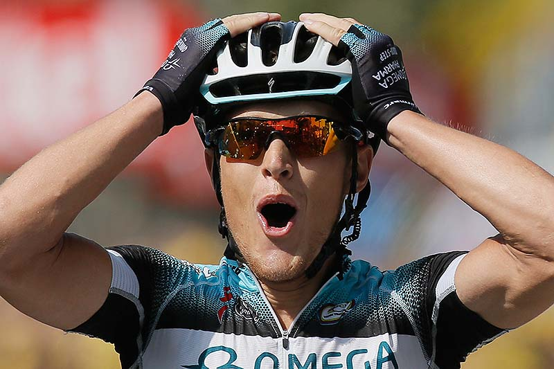 Matteo Trentin of Italy celebrates as he crosses the finish line to win the 14th stage of the Tour de France on Saturday.