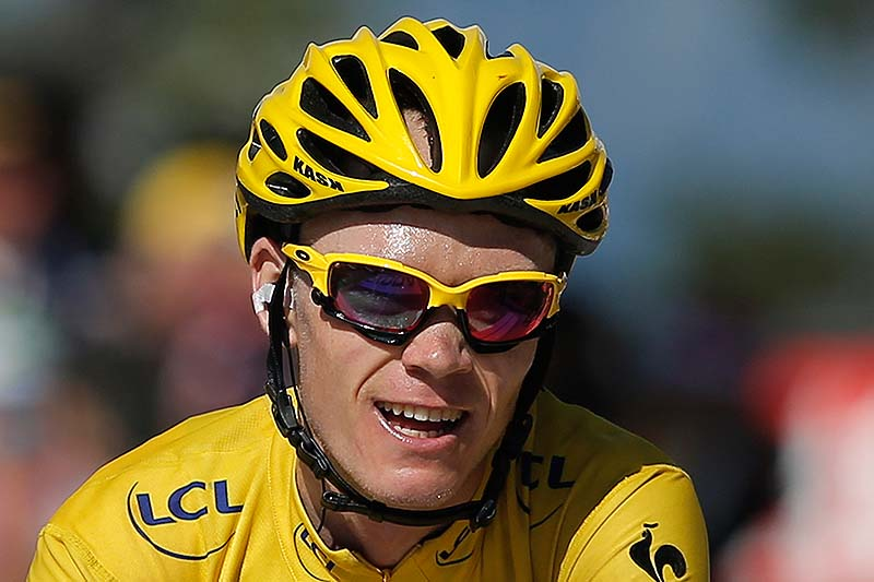 Christopher Froome, wearing the overall leader's yellow jersey, is all smiles as he crosses the finish line in the 20th stage of the Tour de France on Saturday.