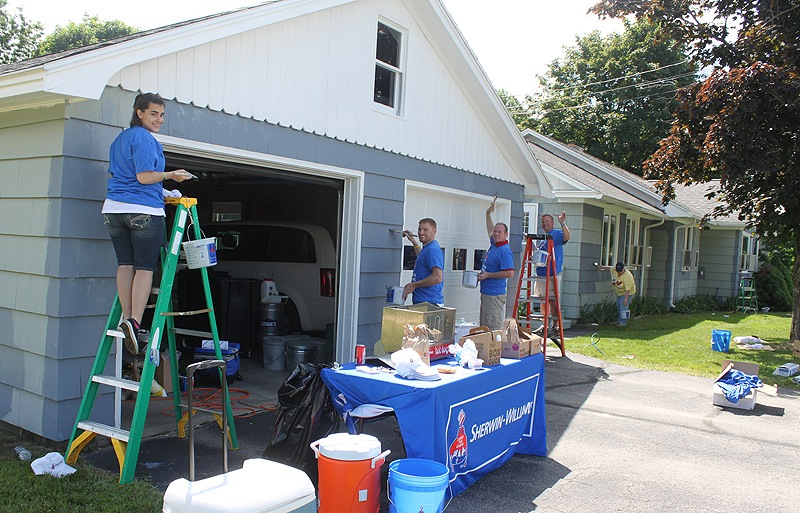 The first day of summer was a perfect day for painting, and Waban's group home on Riverview Street in Sanford was the lucky beneficiary of the Sherwin-Williams National Painting Week donation of supplies, labor and expertise. Volunteer employees from Sherwin-Williams included, from left, Tiffany Poirier from the Yarmouth store; Jason Johnson from the Biddeford store; district manager Tom Pitts; regional manager Bob Decolfmacker; and Springvale store manager Aimee Mattingly painting the Waban group home on Riverview Street.