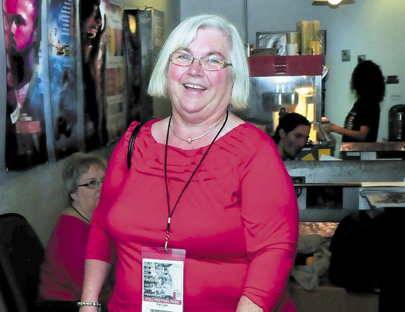 Pat Clark of Unity enters the Railroad Square Cinema to see a Maine International Film Festival movie Sunday.