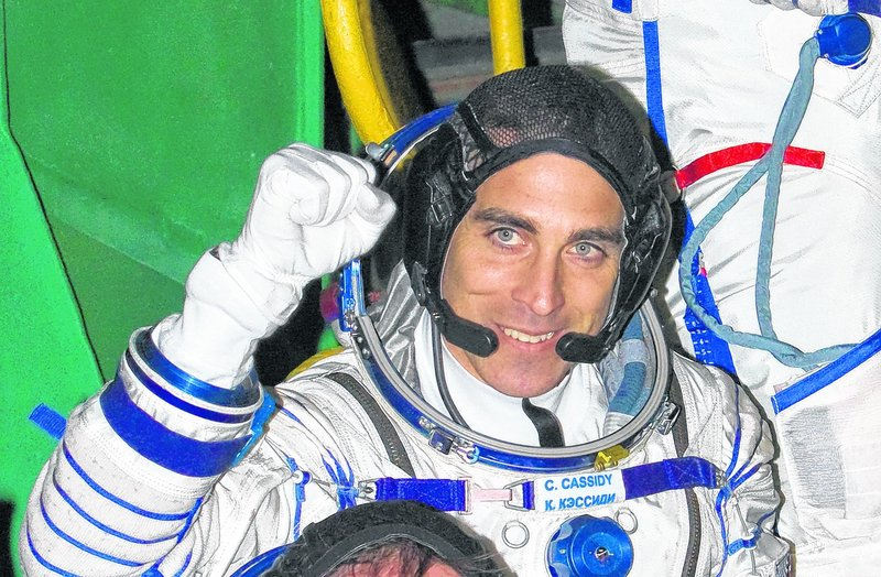 In this file photo, U.S. astronaut Christopher Cassidy, crew member of the mission to the International Space Station (ISS), waves prior to the launch of Soyuz-FG rocket at the Russian leased Baikonur Cosmodrome, Kazakhstan, Thursday, March 28, 2013.