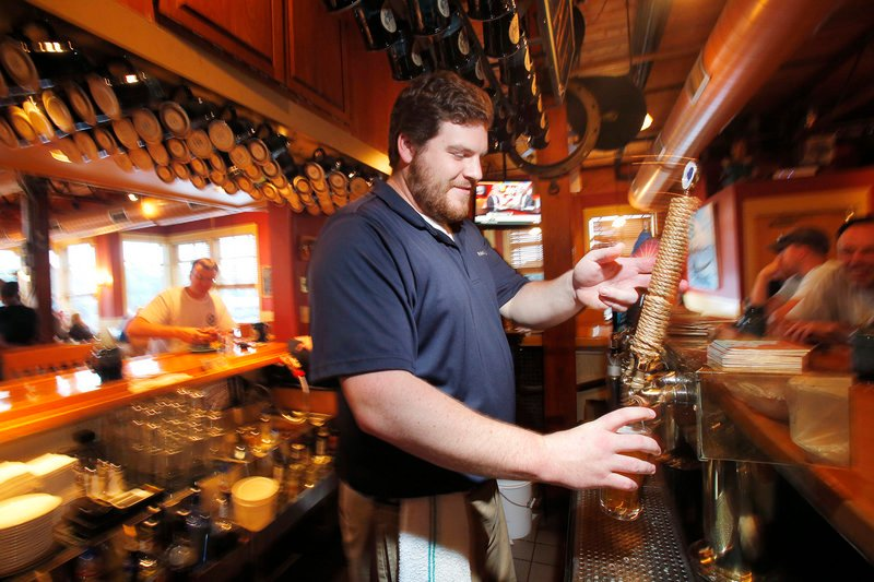 Liam Burns pours a Sunfish Wheat at Federal Jack's in Kennebunk.