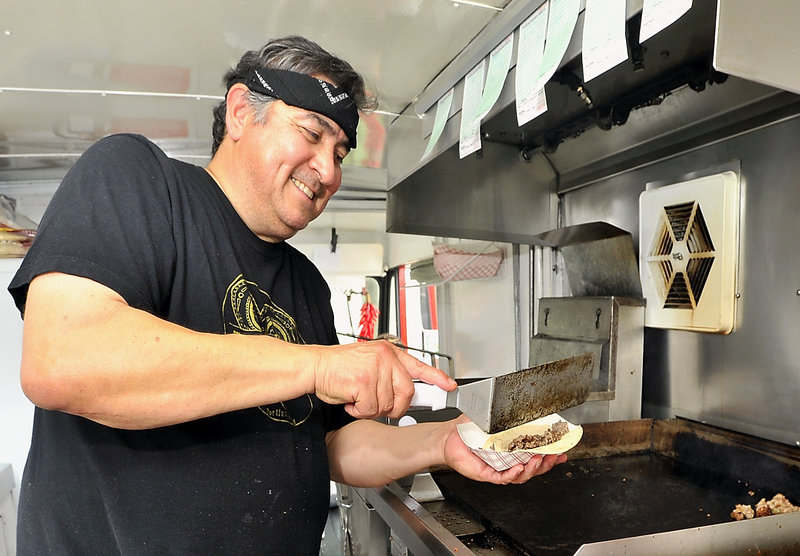 Joe Urtuzuastegui whips up a taco in his El Corazon food truck.