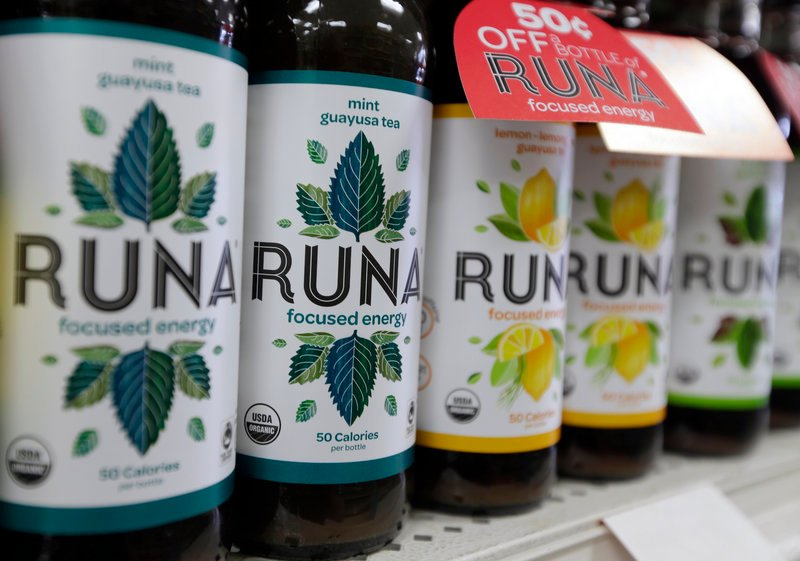 "Bottles of Runa energy drink line a shelf at Dean's Natural Foods store in Albany, N.Y. Runa's hit the shelves recently around the country, boasting caffeine from the guayusa ""super leaf."" It supposedly provides as much caffeine as coffee, with more anti-oxidants than green tea."