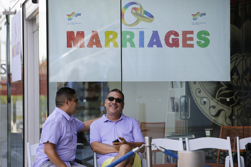 Jose Guerrero, left, and Patrick Rodriguez chat before their wedding ceremony in West Hollywood, Calif., on Monday. The city of West Hollywood was offering civil marriage ceremonies for same-sex couples free of charge Monday.