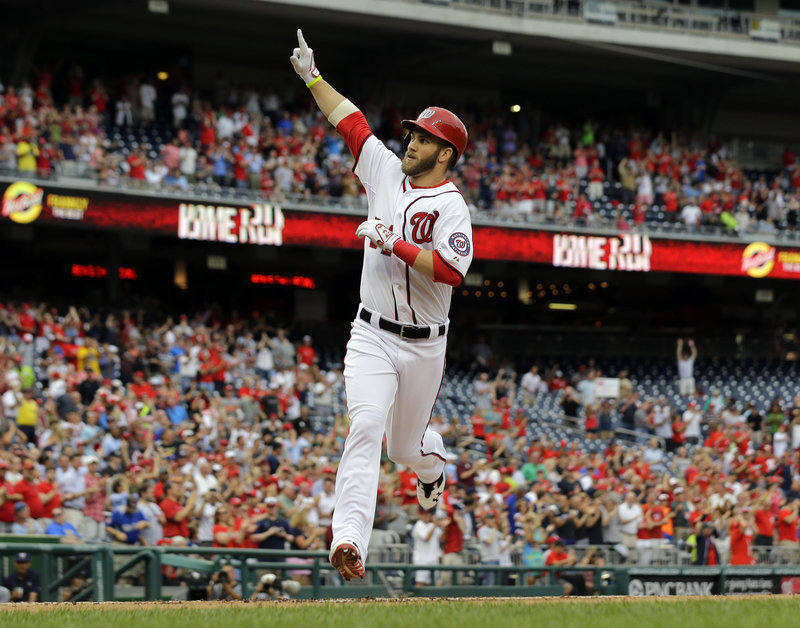 Bryce Harper of the Nationals celebrates after hitting a homer in the first inning Monday night at Washington. Harper homered on his first swing off the disabled list.