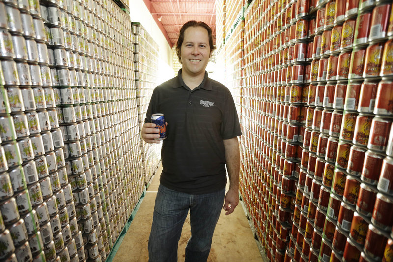 Brewmaster Brian O'Reilly holds a can of Helles Golden Lager with a 360 Lid at the Sly Fox Brewing Co. in Pottstown, Pa.