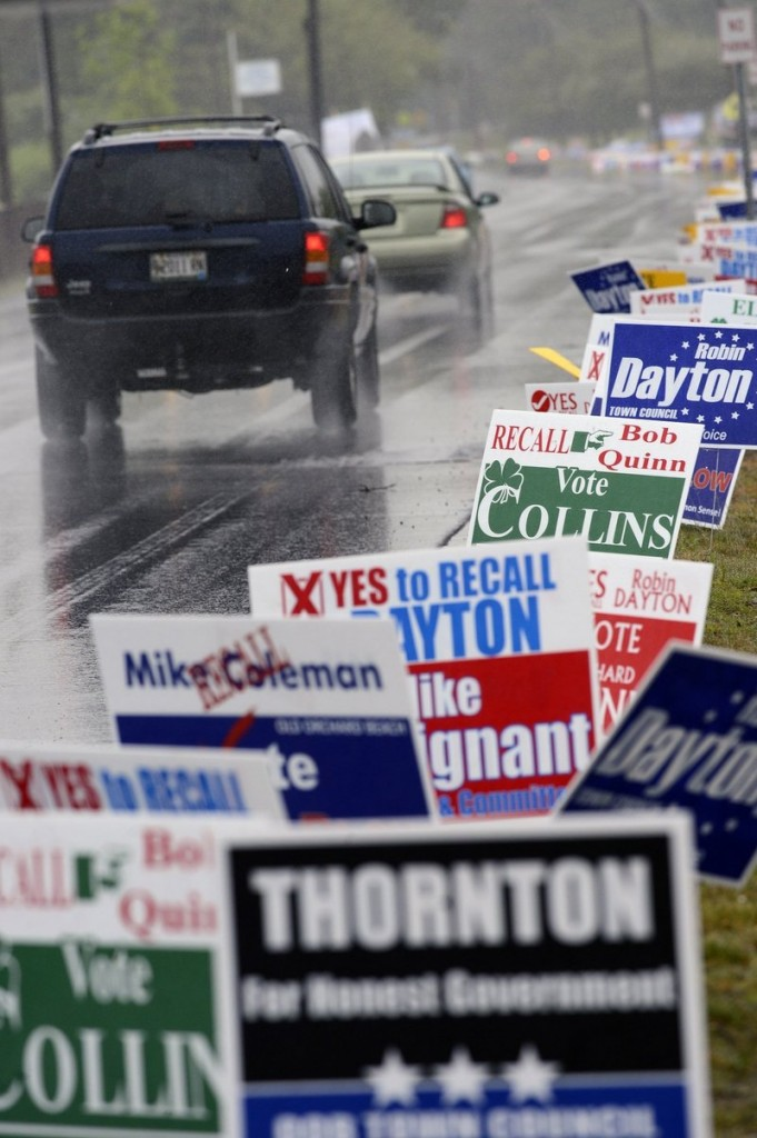 Vehicles pass political signs put up by candidates for office in the June 11 Old Orchard Beach recall election. The success of the Recall 4 effort proves that voters will respond when the issues are explained to them, an Old Orchard Beach resident says.