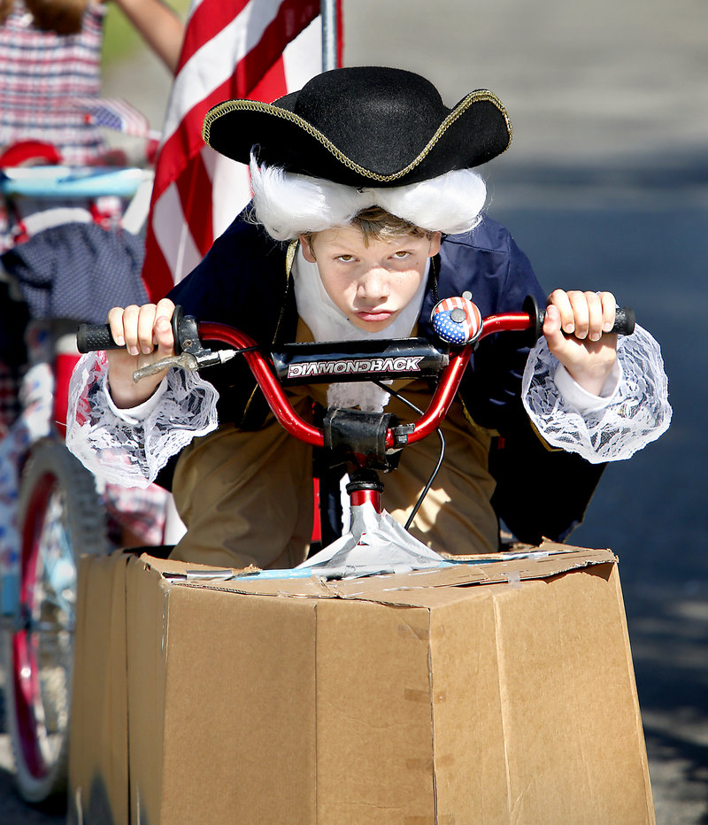 Sam Robles of Ecuador dressed as George Washington and converted his bike into a boat for the decorated bike contest held before the 63rd annual main event in Ocean Park. Sam won first prize in his age group.