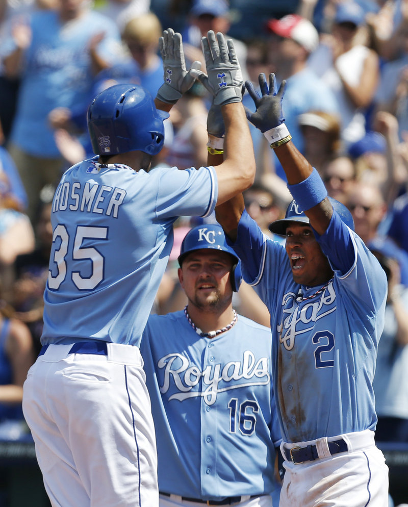 Eric Hosmer gets high-fives from teammates after his two-run homer put the Royals ahead of the Indians in Thursday's 10-7 victory in Kansas City.