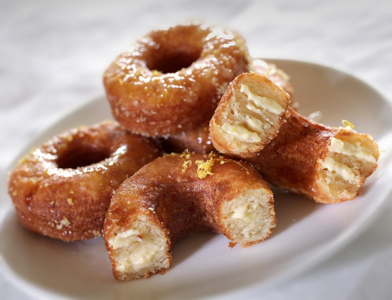 Homemade Cronut-like pastries are a mashup of croissants and doughnuts, fried and filled with pastry cream.