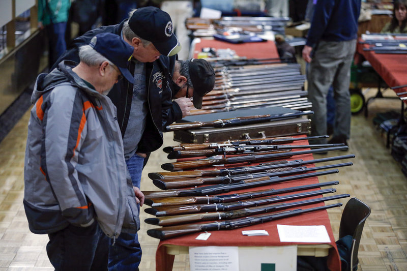 Rifles are displayed at a gun show in Albany, N.Y., in January. A reader says Maine could take a leadership role in preventing gun violence by requiring background checks before private and gun show sales.