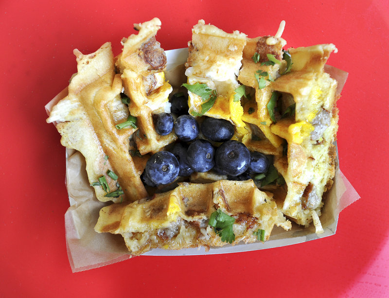 The Kitchen Sink – egg, home fries and choice of meat cooked in a waffle – served at Wannawaf in Portland.