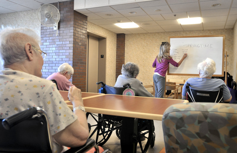 Tina Reese leads a word game for nursing home residents in Lancaster, Pa. The U.S. census counted 425,000 Americans age 95 and older in 2010, 26 percent more than in 2000.