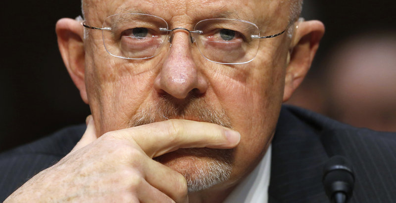 Director of National Intelligence James Clapper testifies March 12 before a Senate Intelligence Committee hearing on national security threats. He testified that the government was not collecting data on millions of Americans, but later said he misspoke.