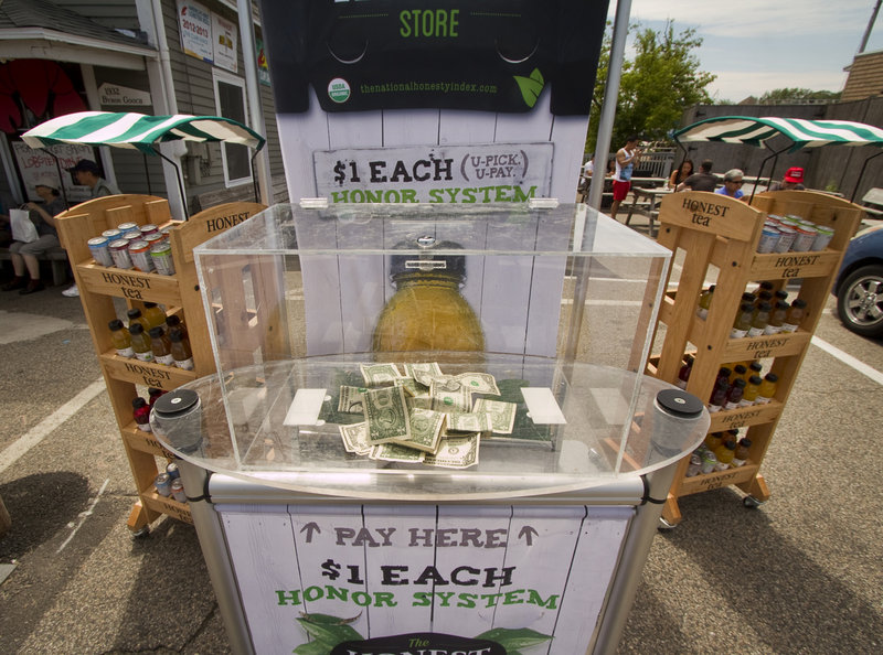 As part of a social experiment to see how honest people are when nobody is looking, Honest Tea placed an honor system booth on Western Avenue in Lower Village, Kennebunk, and observed from across the street on Friday, July 12, 2013.