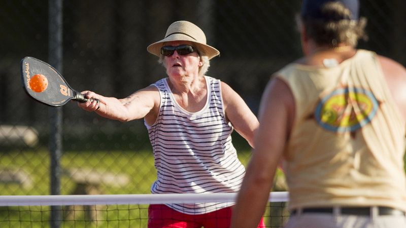 Yvonne Kingsley, 64, of West Baldwin, returns a volley while playing pickleball at Sunset Ridge Golf Course in Westbrook on Friday, July 5, 2013. Pickleball is a game similar to tennis, played with oversized ping pong paddles and a plastic ball like a whiffleball on a small tennis court with a 34-inch net.
